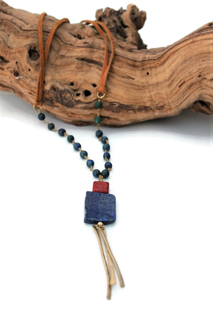 Lapis-pendant-necklace-with-brass-sticks-wire-wrapped-beads-with-leather-cord-on-wood-white-background