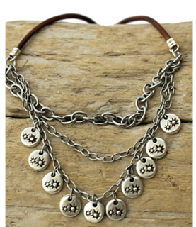 layered chain leather necklace on wood