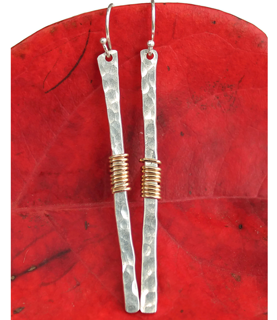 long stick earring on red leaf